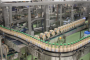 Disruptive compact line layout at BINA Switzerland with an ultra-flexible shrink-wrapping infeed for squared bottles