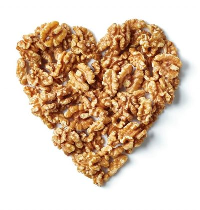 Study links eating just half a serving a day of nuts, such as walnuts, to a decreased risk of cardiovascular disease (CVD)